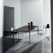 Contemporary dining table / wooden / ceramic / tempered glass