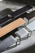 Contemporary bench / wooden / cast aluminum / leather
