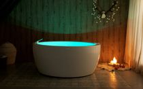 Freestanding bathtub / round / acrylic / deep