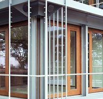 Sliding patio door / wooden / double-glazed / security
