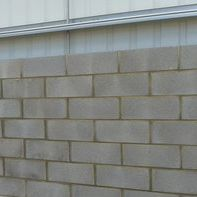 Hollow concrete block / for load-bearing walls / high-resistance / high-performance