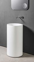 Free-standing washbasin / round / Corian® / contemporary