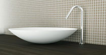 Countertop washbasin / round / Corian® / contemporary