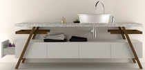 Countertop washbasin / oval / Corian® / contemporary