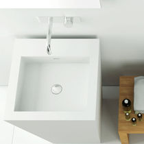 Free-standing washbasin / square / Corian® / contemporary
