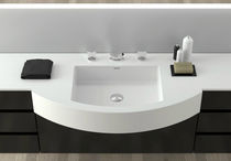 Built-in washbasin / Corian® / contemporary / with adjustable mirror