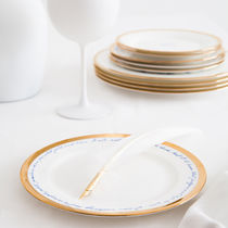 Round plate / porcelain / white / patterned