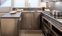 Contemporary kitchen / stone / stainless steel / U-shaped
