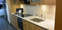 Natural stone countertop / wooden / kitchen / white