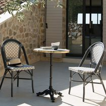 Traditional restaurant chair / with armrests / stackable / wicker