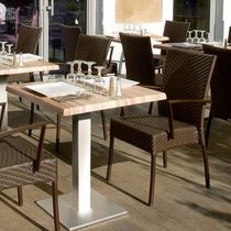 Contemporary restaurant chair / with armrests / stackable / resin wicker