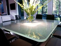 Contemporary dining table / glass / rectangular / outdoor