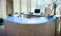 Corner reception desk / glass / illuminated