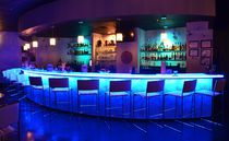 Bar counter / glass / semicircular / illuminated