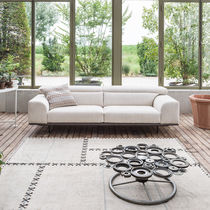 Contemporary sofa / fabric / leather / with reclining back