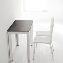 Contemporary table / polycarbonate / rectangular / extending