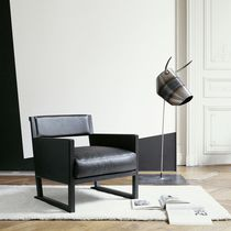 Contemporary armchair / fabric / leather / sled base