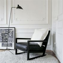 Contemporary armchair / leather / sled base / by Antonio Citterio