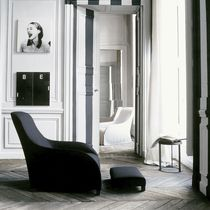 Contemporary armchair / leather / with footrest / bergere