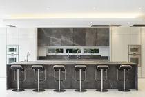 Contemporary kitchen / stone / island