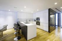 Contemporary kitchen / wenge / Corian® / U-shaped