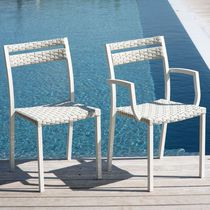 Contemporary chair / stackable / with armrests / resin wicker