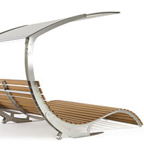 Contemporary sun lounger / water-repellent fabric / iroko / stainless steel