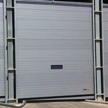 Sectional industrial door / metal / automatic / thermally-insulated