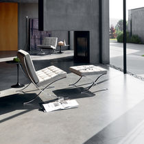 Bauhaus design fireside chair / leather / steel / with footrest
