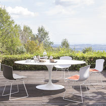 Contemporary dining table / cast aluminum / round / oval