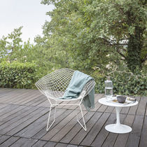 Contemporary armchair / steel / sled base / with removable cushion