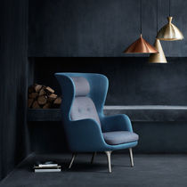 Contemporary armchair / fabric / leather / oak
