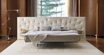 Double bed / contemporary / with upholstered headboard / integrated bedside table