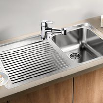 Single-bowl kitchen sink / stainless steel / with drainboard