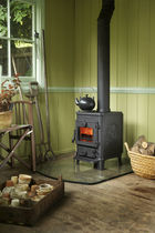 Wood heating stove / multi-fuel / traditional / cast iron