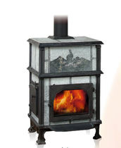 Wood heating stove / traditional / stone / with oven
