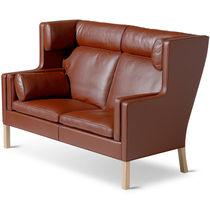 Scandinavian design sofa / leather / oak / walnut