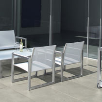 Contemporary armchair / metal / Batyline® / sled base