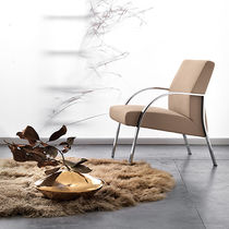 Contemporary armchair / leather / metal / commercial