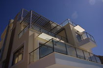 aluminium balcony with glass panels  APERTO ALUMINIUM GROUP