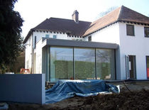 aluminium sliding patio door with thermal break THE WHITE HOUSE  Glass Tech Facades