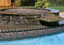 circular built-in hot-tub CUSTOM BUILT IN SPILLOVER SPA LEGACY EDITION POOLS