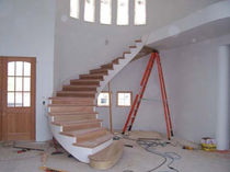 circular floating staircase  ASMAZ WOOD FRAME CUSTOM HOMES