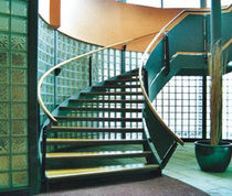 circular staircase with a lateral stringer for commercial buildings (metal frame and wooden steps) DAVID LLOYD CLUB FIRE ESCAPES
