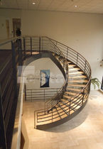 circular staircase with a lateral stringer for commercial buildings (metal frame and wooden steps) TWE-004 EeStairs America