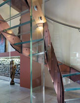 circular staircase with a lateral stringer (metal frame and glass steps) SKIN COLOR EDILCO