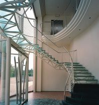 circular staircase with a lateral stringer (metal frame and glass steps) NERI LABEL ESSEMME