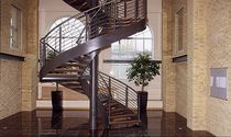 circular staircase with a lateral stringer (metal frame and wooden steps) WARE Crescent Stairs
