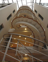 circular staircase with central stringer for commercial buildings by Fletcher Priest Hubbard