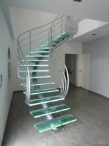 circular staircase with central stringer (metal frame and glass steps) ELCSET la stylique